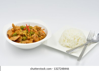 Savory curry with pork and Plain jasmine rice in the white dish.