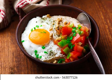 Savory Oatmeal with Cheddar and Fried Egg. selective focus