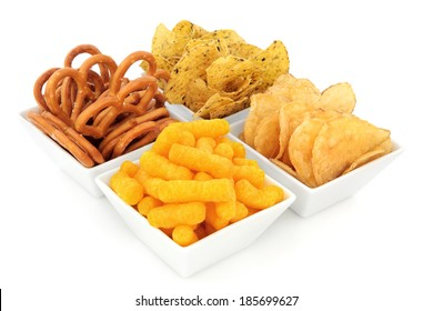 Savory party snack selection in a white porcelain dish.