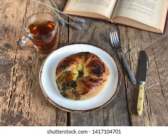 savory pastry and tea on wooden table