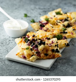 Savory pie with red onion, olives and cheese