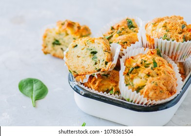 Savory potato spinach and feta muffins in a bowl. White stone background. Copy space.