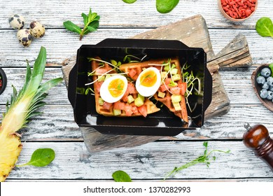 savory waffles with avocado, tomatoes and egg. Delivery of food. Dietary nutrition. Top view. Free copy space.