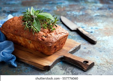 Savoury loaf cake with cheese, peppers and chicken ham, selective focus