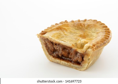 Savoury meat pie with a beef filling studio isolated