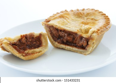 Savoury meat pie with a beef filling on a white plate