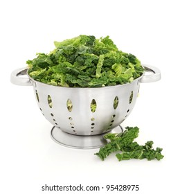 Savoy cabbage chopped in a stainless steel colander isolated over white background.