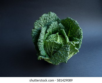 Savoy cabbage isolated on black