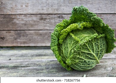 Savoy cabbage on a wooden background