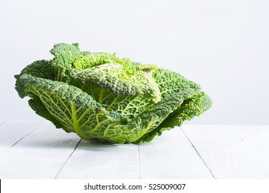 savoy cabbage from organic grower farm, on white wood table