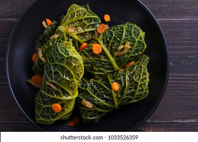 Savoy cabbage rolls with meat, rice and vegetables. Stuffed savoy cabbage leaves. Chou farci, dolma, sarma, golubtsy or golabki - popular dish in many countries. View from above, top, horizontal