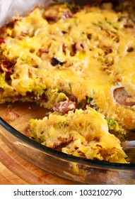 Savoy cabbage, sausage and cheese gratin in a tin