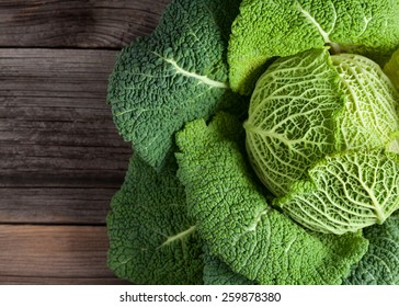 Savoy cabbage super food close up on wooden background. Top view