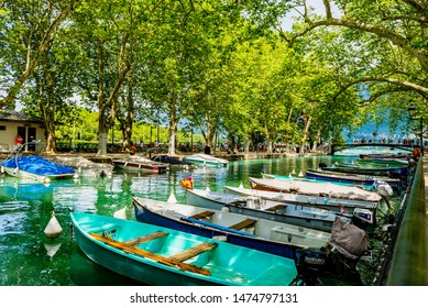 Auvergne-Rhône-Alps; SAVOY; FRANCE - July 6, 2019: View of the colorful boats on the Canal du Vasse' on the Thiou in the city center, in the summer.