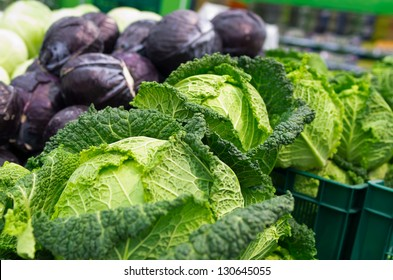 savoy and red cabbage  on the supermarket shelf