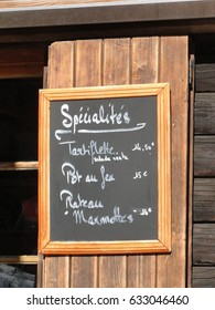 Savoyard specialties on the menu  of a mountain restaurant near Avoriaz, France