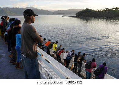 SAVUSAVU, FIJI - JAN 07 2017:Passengers onboard of inter island ferry arrive to Savusavu, Vanua Levu Island.Fiji spread over the southwest Pacific, covering almost 1.3 million km2