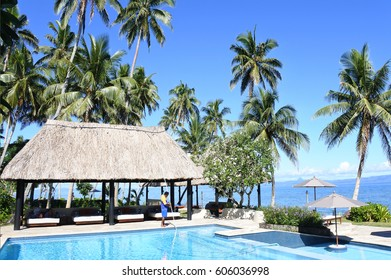 SAVUSAVU, FIJI - JAN 15 2017:Swimming pool service technician.Recreational water illnesses (RWIs) are caused by germs that are spread by swallowing contaminated water present in swimming pools.