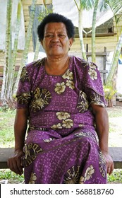 SAVUSAVU, FIJI - JAN 23 2017: Elderly indigenous Fijian woman in her 70's sit outside her village home.   In Fiji life expectancy at birth is 65 for male and 70 for women.