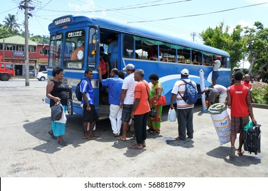 SAVUSAVU, FIJI - JAN 23 2017: Indigenous Fijian people travel by bus. In Fiji every town and village has a bus stop, since this is still the most common form of transportation in the islands.