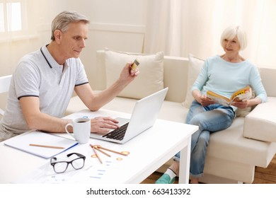 Savvy active aged man using internet banking
