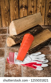 Saw, mittens and firewood, close-up