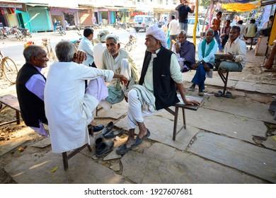 sawai madhopur, rajasthan, India - February 18, 2021: peple talking at roadside tea shop in local market.