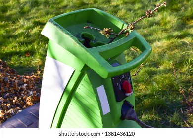 Sawing of branches with a garden shredder. Work the garden with tools and machines. Close-up