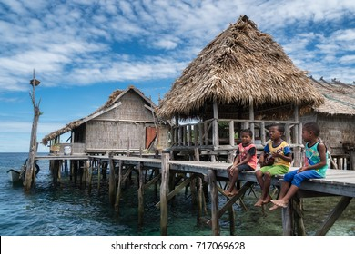 Sawinggrai village, Raja Ampat, West Papua, Indonesia - August 7, 2017 : Children of the village singing a fisherman's song