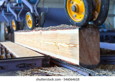 Sawmill. The process of cutting logs into boards. Automatic line sawing. Soft focus