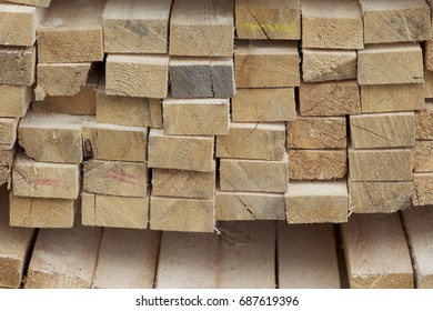 Sawn wooden boards and bars in a pack in stock, Russia