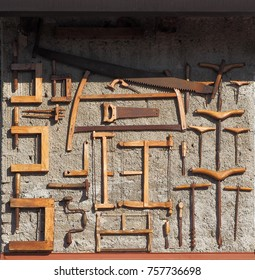 Saws and other ancient woodworking tools, used a long time ago in the carpentry