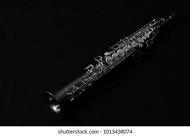sax over the score with black background