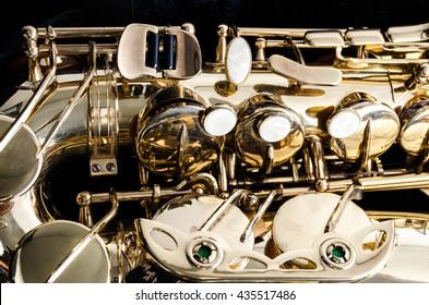 Saxophone alto jazz music instrument close up isolated on black