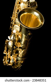 A saxophone, closeup of bell, isolated on black