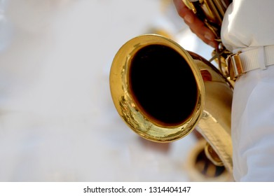 Saxophone Detail and Player in a Brass Band