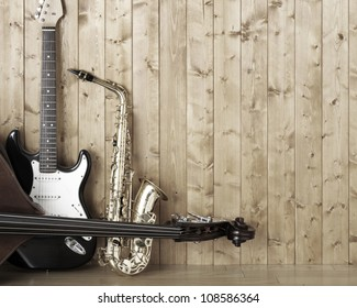 Saxophone guitar and bass in the room