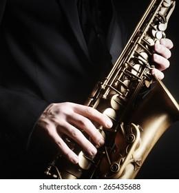Saxophone jazz music instrument Alto sax saxophonist hands Closeup saxophone player