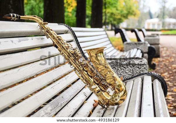 saxophone on a white bench