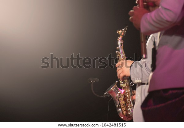 saxophone player with black background