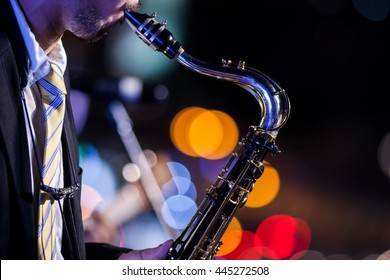 saxophone player with bokeh background