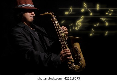 A saxophone player in a dark background with music melody, musical concept