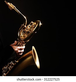 Saxophone player Jazz Music Instrument Baritone Sax isolated on black