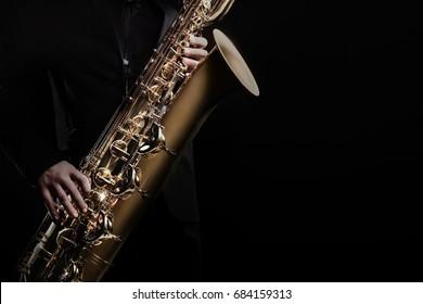 Saxophone player jazz music instrument. Sax player saxophonist with baritone.