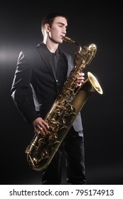 Saxophone player Jazz musician. Baritone sax player blues music playing saxophonist