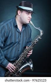 Saxophone player on dark background