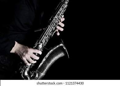 Saxophone player. Saxophonist hands playing sax jazz music instrument closeup