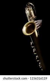 Saxophone player. Saxophonist hands playing jazz music instrument. Baritone sax player isolated