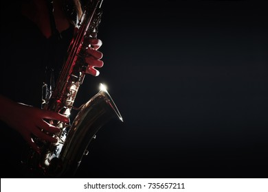 Saxophone Player Saxophonist hands playing jazz music. Sax player close up