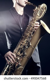 Saxophone Player Saxophonist man playing jazz with baritone. Sax player with music instrument